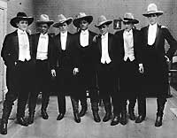 Cowboys in Cowboy Hats and Tuxedos from the Cowboys and Hatters Exhibit